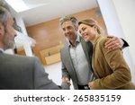 adviser giving handshake to... | Shutterstock . vector #265835159