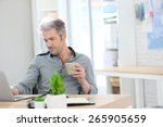 relaxed man working form home...   Shutterstock . vector #265905659