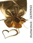 golden heart shaped necklace on ... | Shutterstock . vector #26590963
