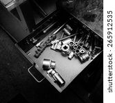 Worn and dirty wrenches in a workshop - stock photo