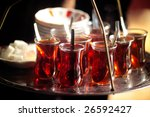 A Man Serving Turkish Tea With...