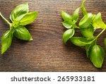 Basil Leaves On Wooden...