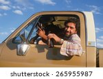 a mexican american in a pickup...   Shutterstock . vector #265955987