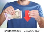 man holding money and red arrow ... | Shutterstock . vector #266200469