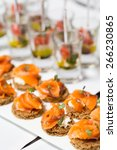 canape with salmon on a white... | Shutterstock . vector #266230865