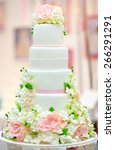 white wedding cake decorated... | Shutterstock . vector #266291291