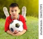 boy with soccer ball | Shutterstock . vector #266317091