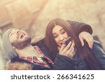 attractive couple doing selfie... | Shutterstock . vector #266341625