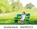boy sit and relax on the chair... | Shutterstock . vector #266392211