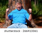 eco warrior chained to a tree... | Shutterstock . vector #266413361