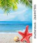 starfish and shell under a palm ... | Shutterstock . vector #266447501