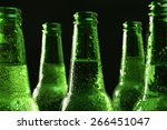Glass Bottles Of Beer On Dark...