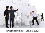 business teamwork - business men making a puzzle over a white background - stock photo