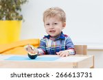 baby with avocado. | Shutterstock . vector #266613731