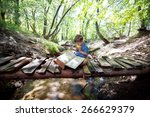 boy reading a book on nature | Shutterstock . vector #266629379