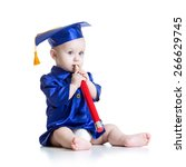 Small photo of Toddler boy with big pencil in academician clothes
