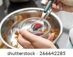 chef seasoning with soy sauce... | Shutterstock . vector #266642285