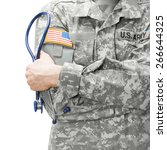 Us Army Doctor Holding...