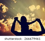 silhouette of a parent holding... | Shutterstock . vector #266679461