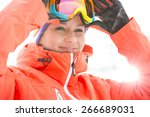 Young Woman Wearing Ski Goggle...