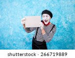 Smiling Mime Holding A White...