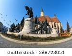 doves flying over the statue of mathias rex in unirii square, cluj-napoca. fisheye shot