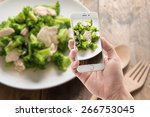 taking photo of broccoli fried... | Shutterstock . vector #266753045