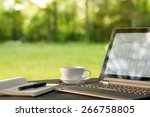 laptop and coffee  outdoor... | Shutterstock . vector #266758805