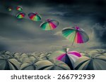 rainbow umbrella in the mass of ... | Shutterstock . vector #266792939