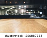 table top with blurred kitchen... | Shutterstock . vector #266887385