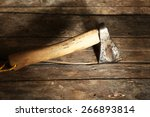 Sharp Axe On Wooden Background