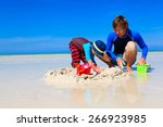 father and son building sand... | Shutterstock . vector #266923985