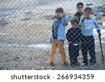 syrian people in refugee camp... | Shutterstock . vector #266934359