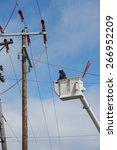 a lineman high in a truck... | Shutterstock . vector #266952209