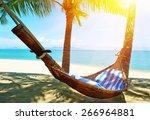 empty hammock between palms...   Shutterstock . vector #266964881