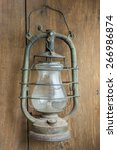 old and rusty kerosene lantern... | Shutterstock . vector #266986874