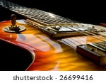 A Les Paul Style Guitar With...