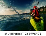 young lady paddling hard the... | Shutterstock . vector #266996471