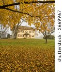 An old building in Monmouth Battlefield State Park in New Jersey framed in golden Fall colors. - stock photo