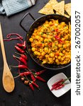 indian chana masala with peas... | Shutterstock . vector #267002057