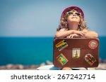 child with vintage suitcase on... | Shutterstock . vector #267242714