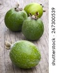 Small photo of Feijoa fruits (Acca sellowiana) on wooden table