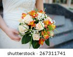 bride is holding a beautiful... | Shutterstock . vector #267311741