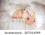 sweet small baby sleeps with a... | Shutterstock . vector #267314399