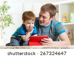 father and son kid playing with ... | Shutterstock . vector #267324647