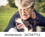Stock photo middle age woman hugging her border collie concept about animals and people 267347711