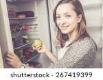 young woman takes fruits and... | Shutterstock . vector #267419399