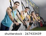 people at gym doing elastic... | Shutterstock . vector #267433439