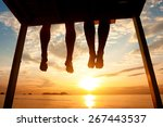 Silhouette Of Feet Of Couple...