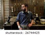 auto mechanic in his workshop | Shutterstock . vector #26744425